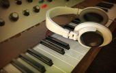 Headphones and electric piano — Stock Photo