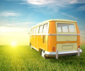 Van traveling in a field at sunset — Stock Photo