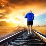 Man running on train tracks — Stock Photo #77851458