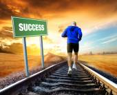 Man running on train tracks — Stock Photo