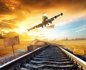 Airplane landing on the tracks of the train — Stock Photo