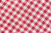 Texture of a red and white checkered tablecloth. — Fotografia Stock