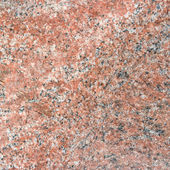Red granite background with natural pattern. — Stock Photo
