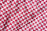 Red picnic  tablecloth background. — Stock Photo