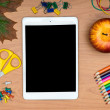 School supplies and tablet on wooden school desk from above — Stock Photo #51865111