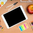 School supplies and tablet on wooden school desk from above — Stock Photo #51865113