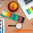 School supplies and tablet on wooden school desk from above — Stock Photo #51865201