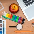 School supplies and tablet on wooden school desk from above — Stock Photo #51865221