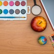 School supplies and tablet on wooden school desk from above — Stock Photo #51865879