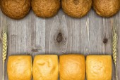 Bread on a wooden background — Stock Photo