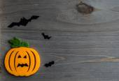 Whimsical Halloween background image of handmade felt jack-o-lantern on rustic wood — Stock Photo