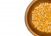 Dry corn grains in wooden bowl — Stock Photo