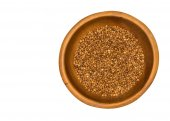 Dry buckwheat grains in wooden bowl — Stock Photo