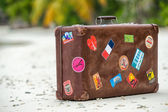 Travel vintage suitcase is alone on a beach — Stock Photo