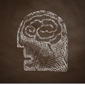 Head icon on chalkboard — Stock Vector