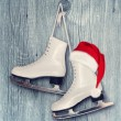 Pair of White Ice Skates and Santa Claus hat - backround on vint — Stock Photo #55784807