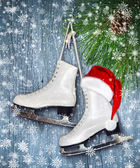 Pair of White Ice Skates and Santa Claus hat - backround — Stock Photo