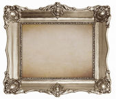 Old silver frame with empty canvas texture background — Stock Photo