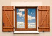 Window and shutters and sky  — Stockfoto