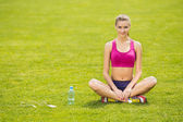 Girl sitting in the lotus position — Stock Photo