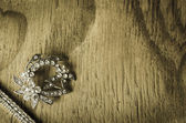 Jewelry on Rustic Wood — Stock Photo