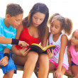 Girl reading to siblings — Stock Photo #61117661