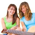 Teenage girls listening to music — Stock Photo #61117955