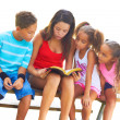 Girl reading to siblings — Stock Photo #61118923