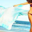 Girl with pareo at beach — Stock Photo #61119087