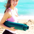 Female holding yoga mat — Stock Photo #61119119