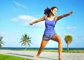 Girl doing yoga warrior pose — Stock Photo