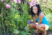 African-American woman gardening — Stock Photo