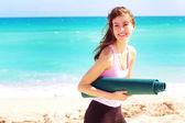 Female holding yoga mat — Stock Photo