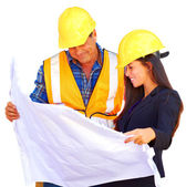 Architect and foreman reviewing blueprint — Stock Photo