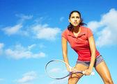 Female athlete playing tennis — Stock Photo