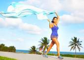 Jogger with flowing banner — Stock Photo