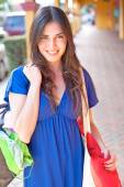Girl with bags smiling — Stock Photo