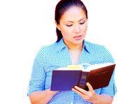 Asian woman reading Bible — Stock Photo