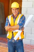 Building contractor with blueprints — Stock Photo
