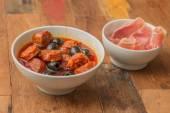 Chorizo al cava with black olives — Stock Photo
