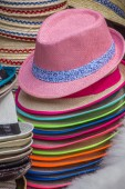 Stack of colorful hats at romanian market — Stock Photo