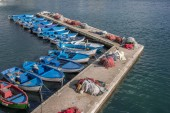 Fishing boats and nets on a pier in Gallipoli — Stock Photo