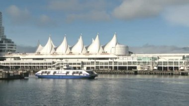 Boat passing Canada Place in Vancouver — Stock Video