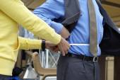 Fitness Coach measures the waist of a man. — Stock Photo