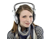 Woman listens to music — Stock Photo