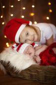 Christmas sleeping newborn baby with sister — Stock Photo