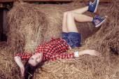 Attractive girl in hay — Stock Photo
