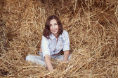 Attractive girl in hay — ストック写真