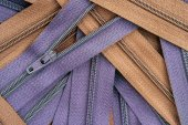 Purple and brown clothing zippers — Stock Photo