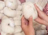 Shopping for white knitting wool — Stock Photo